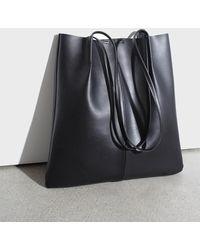 Glassworks Black Vegan Leather Pinched Strap Tote Bag
