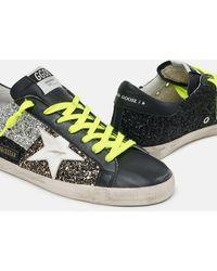 Golden Goose Sneakers Super-Star mit Einsätzen aus Glitzer in Gold, Silber und Schwarz - Mettallic