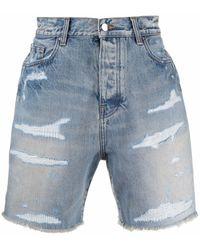 Amiri Shorts denim con effetto vissuto - Blu