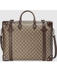 Gucci 【公式】 (グッチ)レザー ディテール付き スーツケース GGスプリーム キャンバスベージュ - マルチカラー