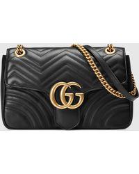Gucci Mittelgroße GG Marmont Schultertasche aus Matelassé - Schwarz