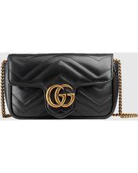 Gucci GG Marmont Super Mini Tasche aus Matelassé Leder - Schwarz