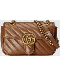 Gucci GG Marmont Mini Schultertasche aus Matelassé Leder - Braun