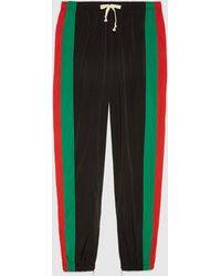 Gucci Lässige Jogginghose aus wasserdichtem Nylon - Schwarz
