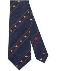 Gucci Krawatte aus Seidensablé mit Bienen-Motiv und Webstreifen - Blau