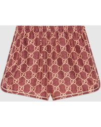 Gucci Shorts aus Seide mit GG Supreme Print - Rot