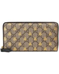 038fbb36f2a1 Lyst - Gucci Gg Supreme Zip Around Wallet in Gray