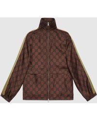 Gucci Jacke aus Seide mit Reißverschluss und GG Print - Braun