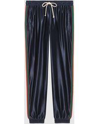 Gucci 【公式】 (グッチ)ウェブ ストライプ付き シャイニージャージー パンツブルーブルー