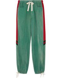 Gucci Lässige Jogginghose aus Denim mit Web - Grün