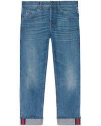 Gucci Jean fuselé bleu avec détail ruban Web