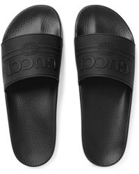 Gucci Pantolette aus Kautschuk mit Logo - Schwarz