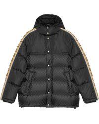 Gucci Abrigo acolchado de nylon de jacquard con GG - Negro