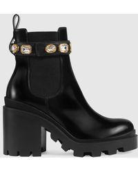 Gucci Stiefelette aus Leder mit Gurt - Schwarz