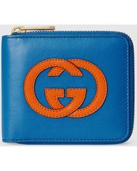 Gucci Brieftasche mit Rundumreißverschluss und GG - Blau