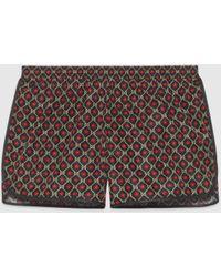 Gucci Badeshorts aus Nylon mit GG Sternen-Print - Schwarz