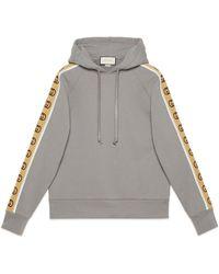 Gucci Sweat-shirt à capuche en jersey de coton - Gris