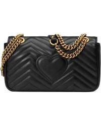 Gucci Sac à épaule petite taille à motif GG Marmont matelassé - Noir