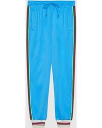 Gucci グッチウェブ付き テクニカルジャージー ジョギングパンツ - ブルー