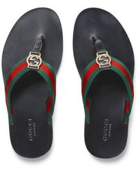 Gucci Zehenstegsandalen mit -Webstreifen - Grün