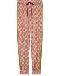 Gucci Pantalon en soie à imprimé GG Supreme - Multicolore