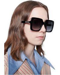 Gucci Lunettes de soleil rectangulaires en acétate - Noir