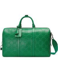 Gucci Reisetasche aus geprägtem GG Leder - Grün