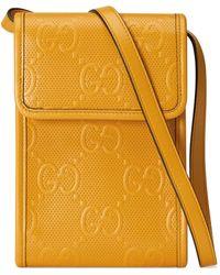 Gucci Minibolso con GG en relieve - Amarillo