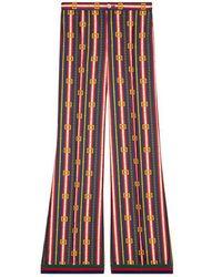 Gucci Pantalone pigiama in seta con stampa cinture GG Quadro - Multicolore