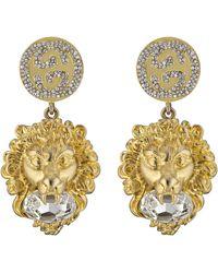 Gucci Pendientes con cabeza de león y GG - Multicolor