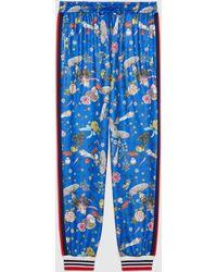 Gucci 【公式】 (グッチ)日本限定 ヒグチユウコ マッシュルームプリント ジョギングパンツブルーブルー