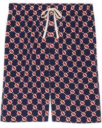 Gucci Shorts aus Seiden Crêpe mit sechseckigem GG Print - Blau