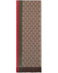 Gucci Bufanda de punto de jacquard GG con tribanda y fleco - Neutro