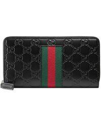 Gucci - Signature Web Zip Around Wallet - Lyst