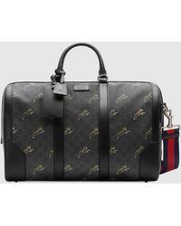 Gucci Reisetasche aus weichem GG Supreme mit Tigern - Schwarz