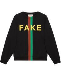 Gucci Sweat-shirt à imprimé « Fake/Not » - Noir