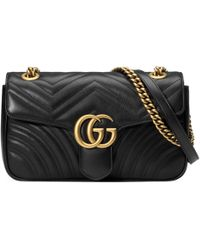 Gucci Kleine GG Marmont Schultertasche aus Matelassé - Schwarz