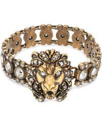 Gucci Pulsera con cabeza de león y cristales - Metálico