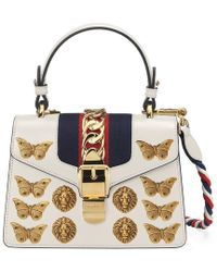 9500d1c8af8a Lyst - Gucci Marmont Animal Studs Leather Mini Bag in Black
