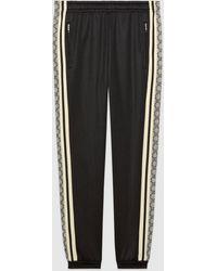 Gucci Übergroße Jogginghose aus technischem Jersey - Schwarz