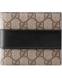 Gucci Brieftasche aus GG Supreme-Canvas - Schwarz