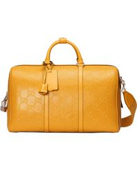 Gucci GG Embossed Duffle Bag - Yellow