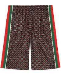Gucci Short en jersey à imprimé GG et étoiles - Noir