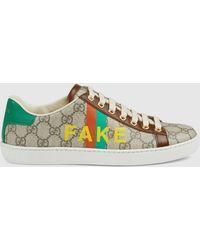 "Gucci Ace Damensneaker mit ""Fake/Not"" Print - Natur"