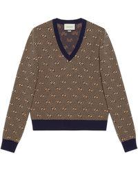 Gucci Pull col en V en laine à rayures et motif GG - Marron