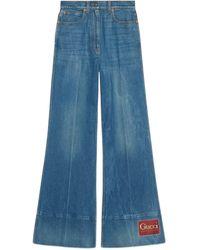 Gucci Schlaghose aus Denim mit Waschung und Etikett - Blau