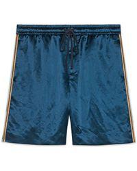 Gucci - Shorts bimateriale con stampa - Lyst