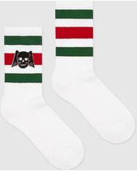 Gucci Socken mit geflügeltem Totenkopf - Weiß
