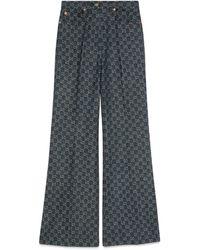 Gucci Pantalon ample en jean GG délavé écologiquement - Bleu