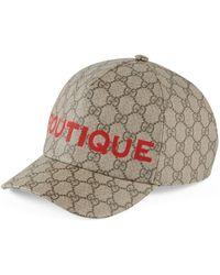 Gucci Casquette à imprimé Boutique GG - Neutre